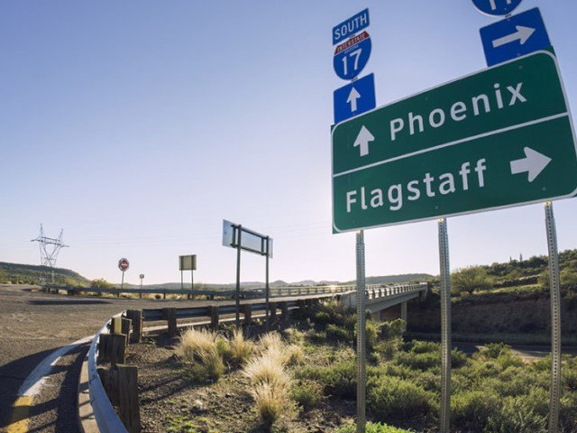 Highway Sign with City Names